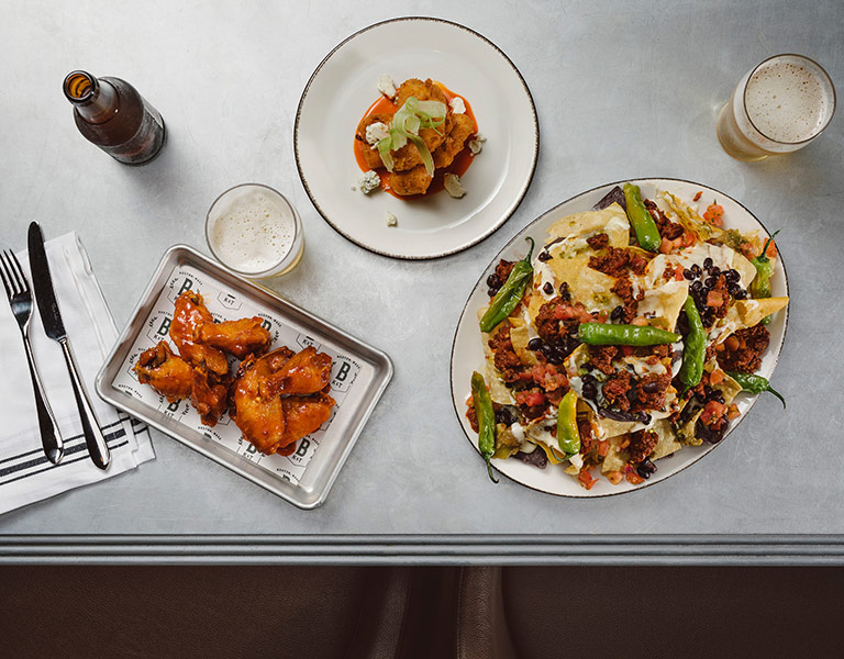 Wings, Nachos, and Buffalo Cauliflower served at Banners Kitchen & Tap near TD Garden