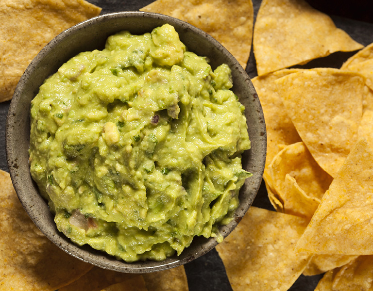 Guacamole and chips served at Chef Street in NYC