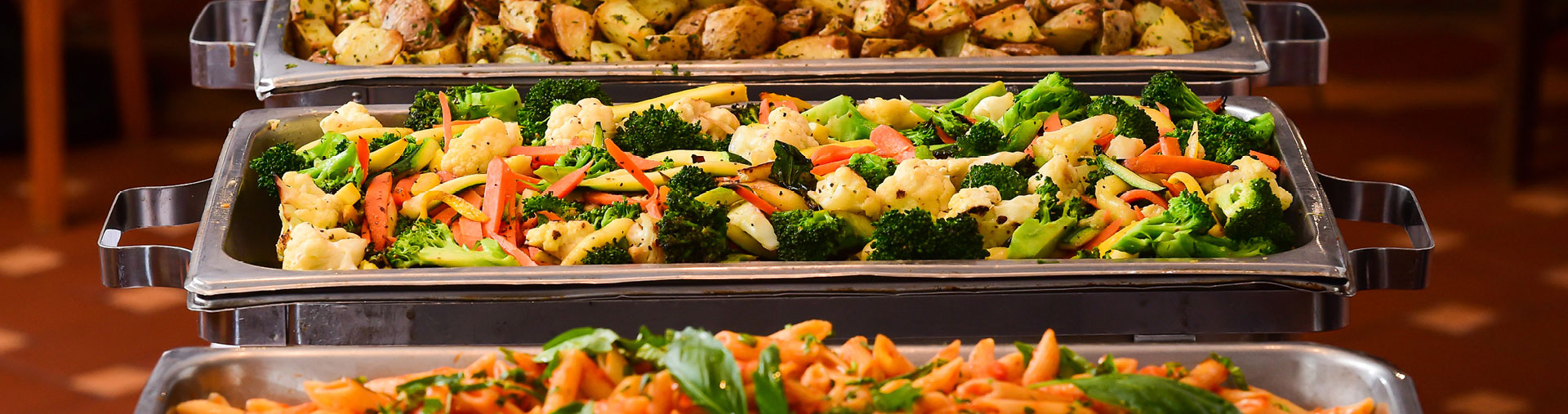 Private event buffet vegetable and pasta served at Cucina & Co. Rockefeller Center in midtown NYC