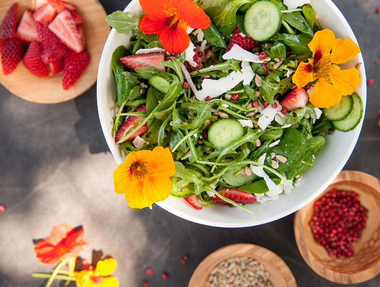 The Kitchen Arugula and Strawberry Salad served at The Kitchen at Descanso at Descanso Gardens