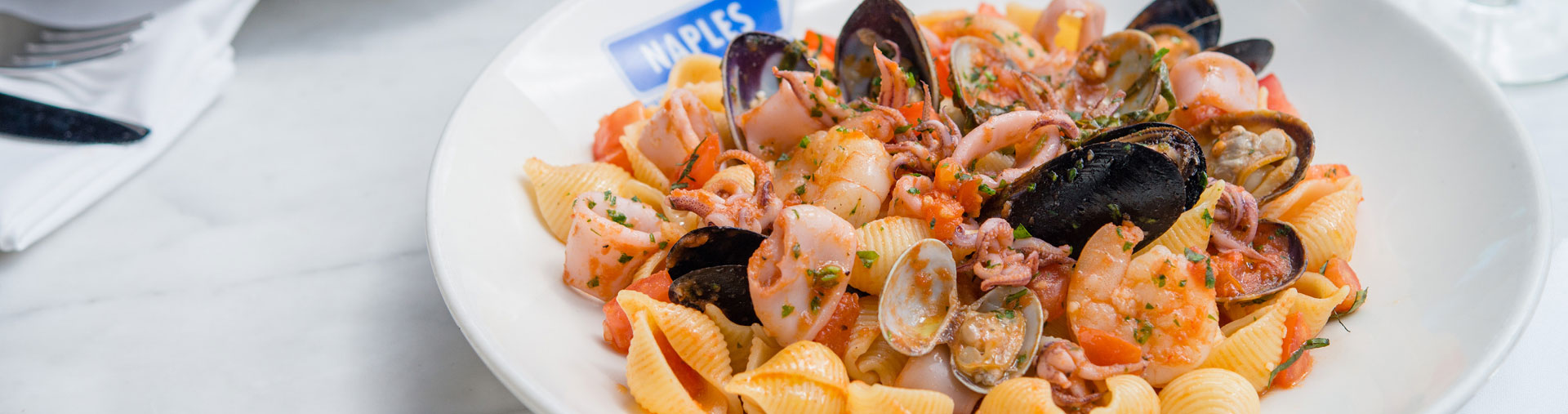 Seafood and pasta entree served at in Anaheim, CA at Naples Ristorante E Bar