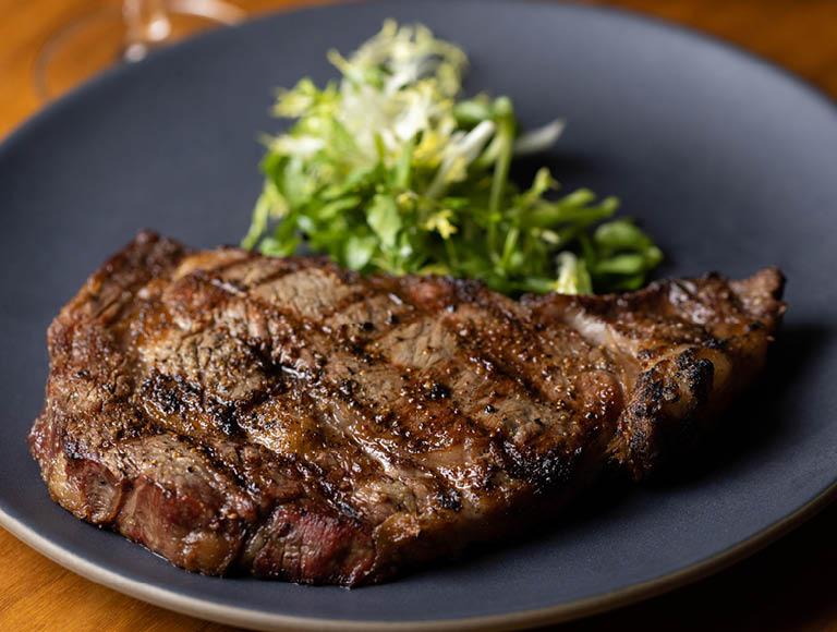 Single piece of steak on a plate