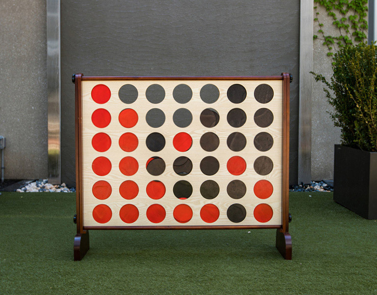 Giant Connect 4 game inside Patina 250's outdoor courtyard in Buffalo
