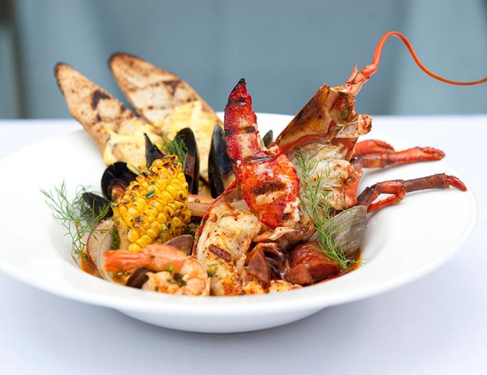 Lobster, shrimp, clams and corn entrée | Downtown Buffalo, NY Dining