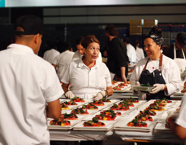 catering staff plating food