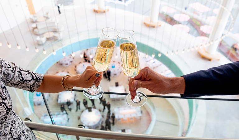 Two people toast with champagne glasses