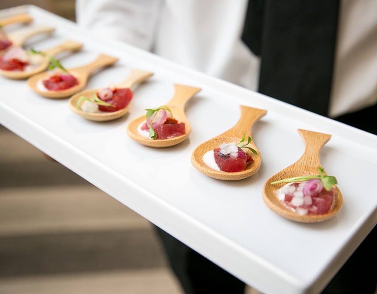 Wedding appetizers served on wooden spoons