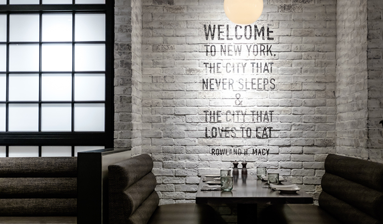 The city that never sleeps & the city that loves to eat - Rowland H. Macy quote inside Rowland's Bar & Grill
