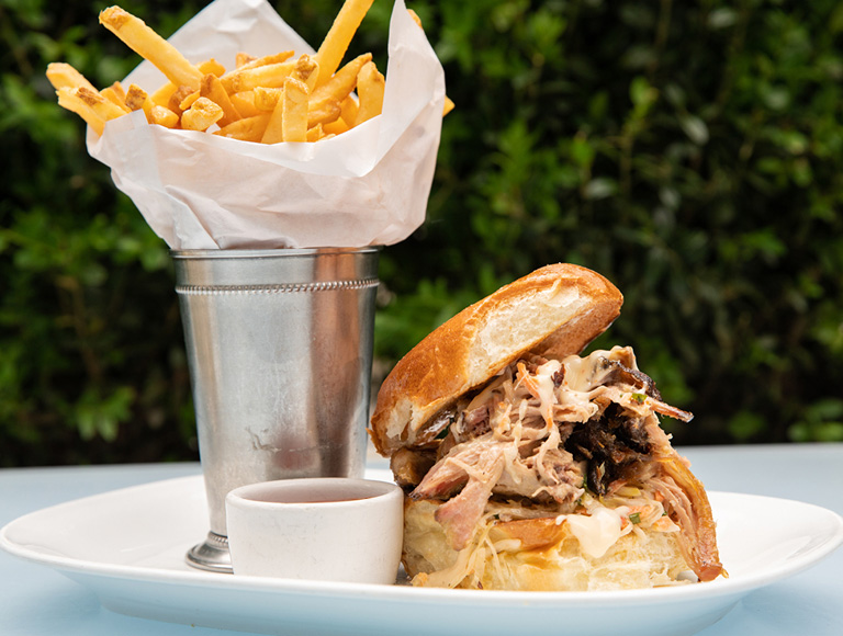 Pulled pork sandwich with fries served at Summer Garden & Bar in NYC