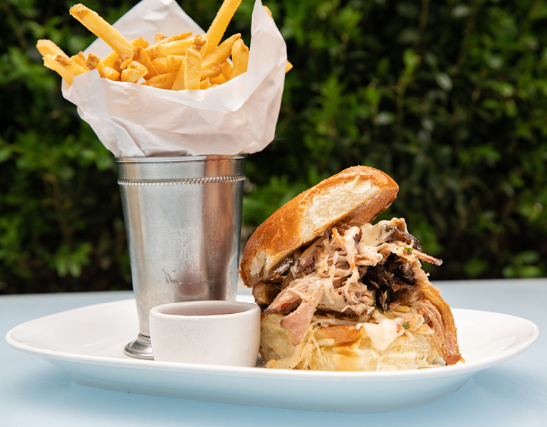 House-smoked pulled pork sandwich with fries