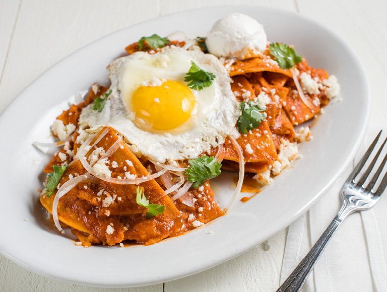Chilaquiles topped with fried egg, Mexican dining at Downtown Disney District