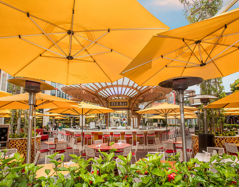 Orange umbrellas at Uva Bar & Cafe's outdoor circle bar in Downtown Disney