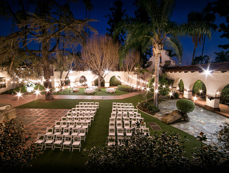Outdoor wedding venue at night with bright decorative lights