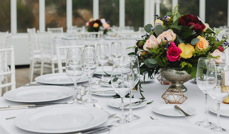 Dining tables are set for an event at Brooklyn Botanic Garden