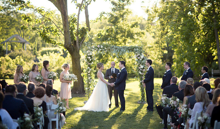 A couple gets married outside at Brooklyn Botanic Garden