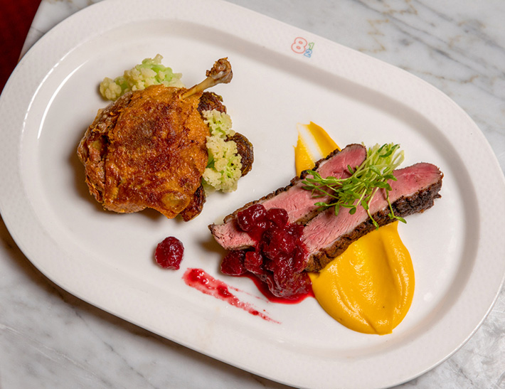 Duck entrée served at Brasserie 8 1/2 in NYC