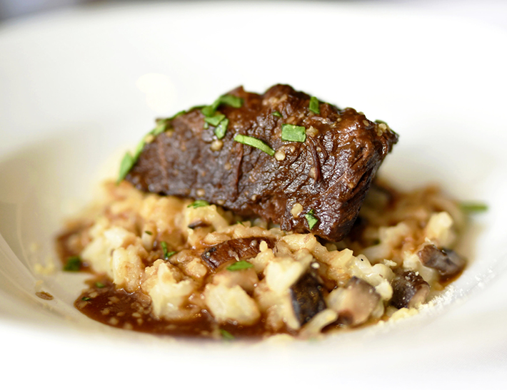 Short rib with mushroom risotto served at Nick + Stef's Steakhouse in NYC