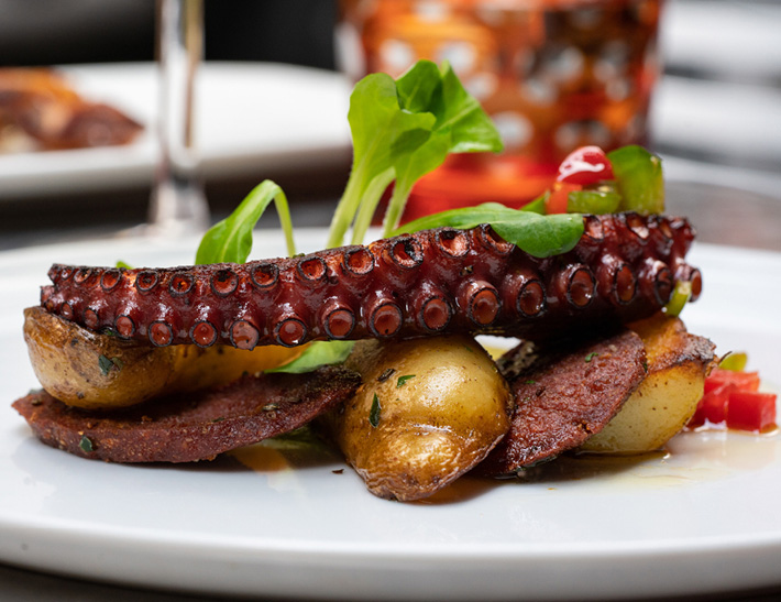 Octopus entrée served at La Fonda del Sol in NYC