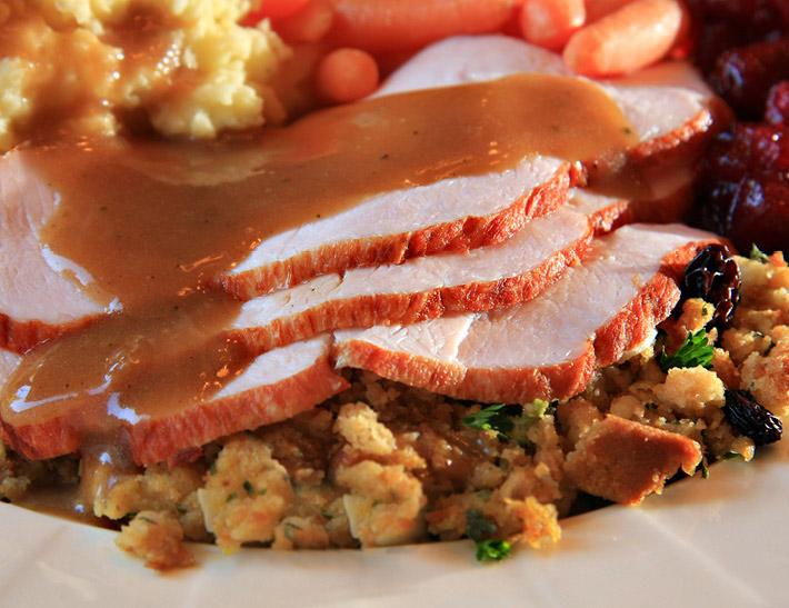 Roast turkey served with gravy and stuffing